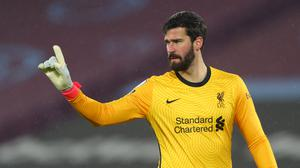 Liverpool goalkeeper Alisson made some uncharacteristic blunders against Man City (Clive Rose/PA)