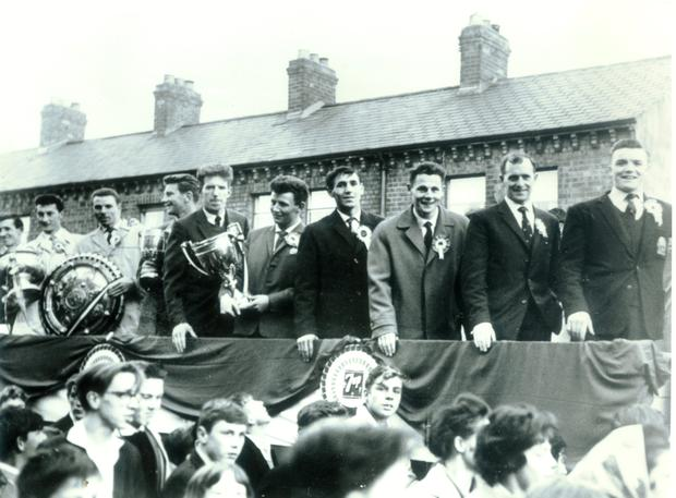 Glory boys: the all-conquering Linfield squad celebrate their remarkable seven-trophy haul in 1962 with their fans