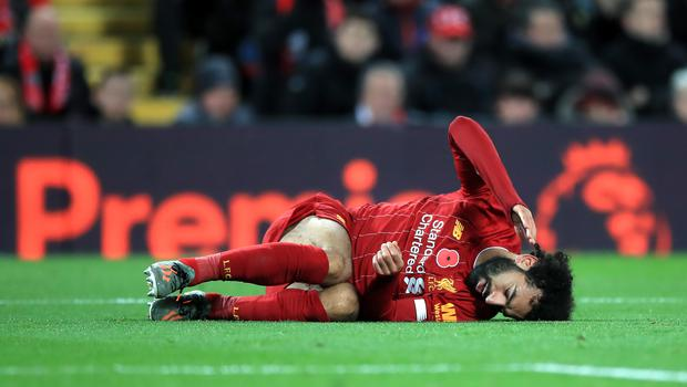 Mohamed Salah has been struggling with an ankle injury of his own (Peter Byrne/PA)