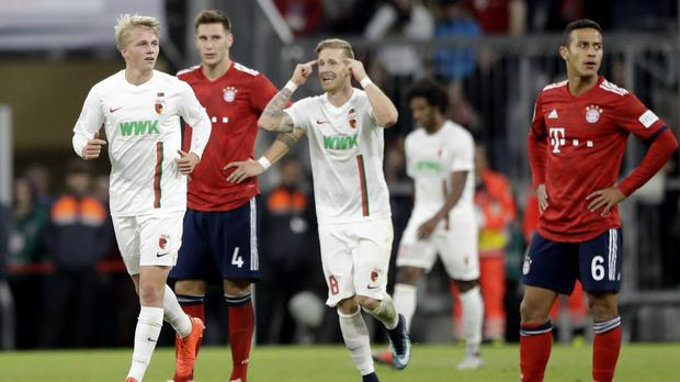 Augsburg produced a late rally to earn a 1-1 draw at Bundesliga leaders Bayern Munich (Matthias Schrader/AP)