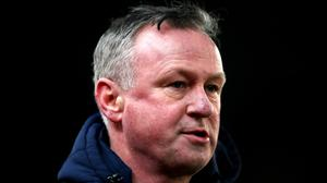 Michael O'Neill faces an uncertain build-up to the match (Nick Potts/PA)