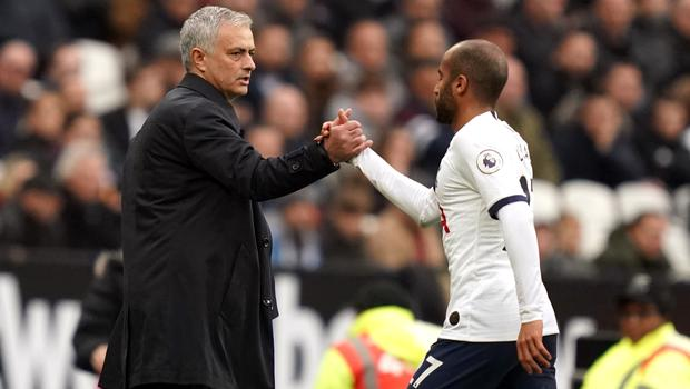Mourinho (left) shakes hands with Moura as he is substituted at West Ham (John Walton/PA)