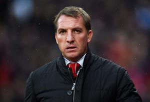 Under a cloud: Brendan Rodgers is feeling the pressure at Liverpool for the first time after four successive defeats