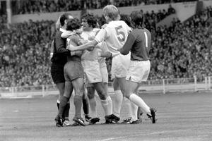 Hunter and referee Reg Matthewson try to break up a fight between Leeds midfielder Billy Bremner and Liverpool forward Kevin Keegan during the 1974 Charity Shield at Wembley (PA)