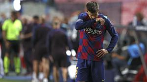 Gerard Pique reacts after the Barcelona's Champions League thrashing by Bayern Munich (Rafael Marchante/AP).