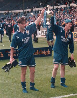 Steve Claridge, right. celebrates the play-off win over Crystal Palace at Wembley in 1996 with team-mate Garry Parker (PA)