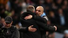 Pep Guardiola, right, embraces Manchester United manager Ole Gunnar Solskjaer after the Carabao Cup semi-final (Tim Goode/PA)