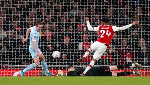 Arsenal's Reiss Nelson scores his side's winning goal during the FA Cup third round against Leeds (John Walton/PA)