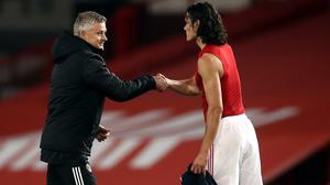 Manchester United manager Ole Gunnar Solskjaer, shown shaking hands with Edinson Cavani, is remaining cautious despite his side's return to form at Old Trafford on Tuesday (Martin Rickett/PA)