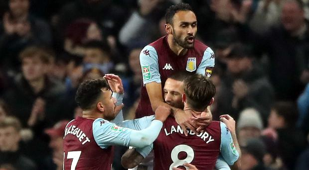 Aston Villa celebrate scoring their first in a 5-0 Carabao Cup quarter-final win over Liverpool courtesy of Conor Hourihane (Nick Potts/PA)