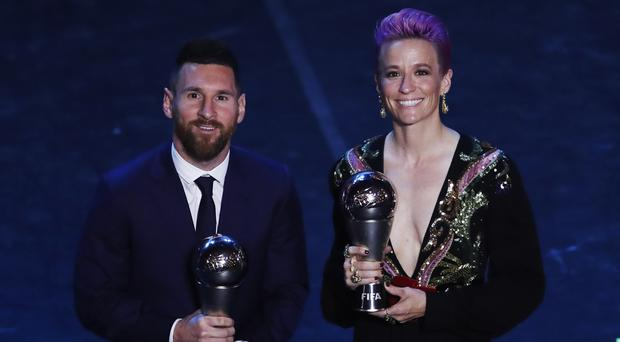 Lionel Messi, left, pictured with US women's star Megan Rapinoe after winning his FIFA award (Antonio Calanni/AP)