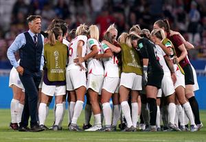 Neville, left, and the players during a huddle (John Walton/PA)