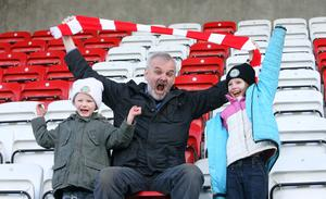 Family guy: Tim McGarry with Stephen Magee and Martha Rose McCamley in Cliftonville's family section at Solitude