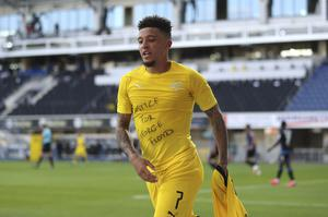 Jadon Sancho removes his shirt to reveal his protest T-shirt after scoring for Borussia Dortmund against Paderborn.