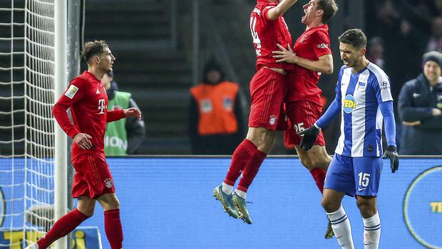 Ivan Perisic, second left, celebrates after scoring Bayern's fourth goal in the win at Hertha Berlin (AP).