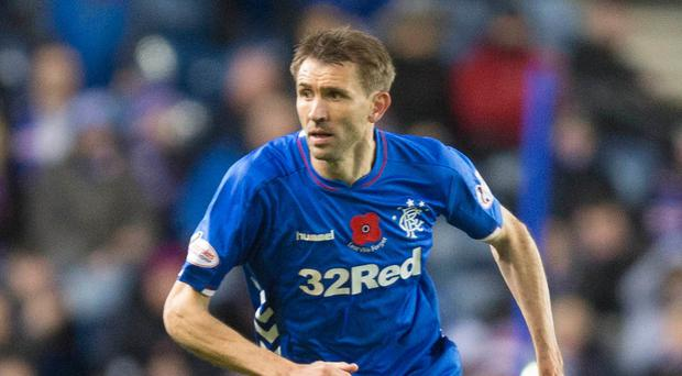Gareth McAuley in action for Rangers (Jeff Holmes/PA)