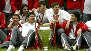Liverpool captain Steven Gerrard, second right, and team-mates with the Champions League trophy (Phil Noble/PA)
