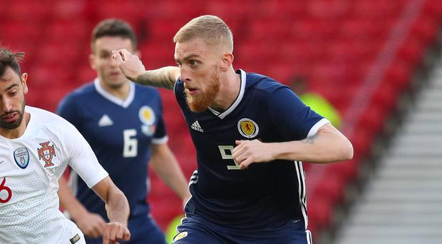Can Oli McBurnie score his first goal for Scotland? (Jane Barlow/PA)