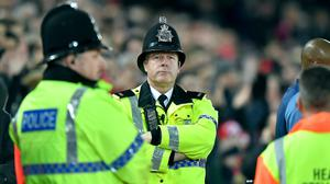 Police officers at Anfield (Dave Howarth/PA)