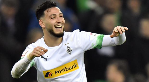 Ramy Bensabaini was Borussia Moenchengladbach's hero with both goals in a 2-1 home win over Bayern Munich (Martin Meissner/AP)