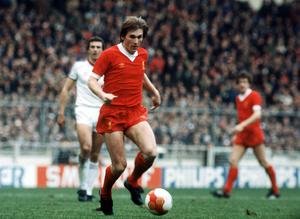Sir Kenny, shown playing for Liverpool, went to hospital for gallstones but returned a positive test for Covid-19 (PA)