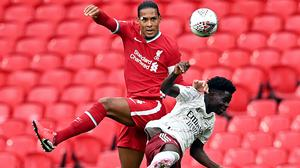 Liverpool's Virgil van Dijk (left), pictured challenging Arsenal's Bukayo Saka, says the champions should not panic over their Community Shield defeat against the Gunners at Wembley.