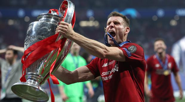 James Milner wants Liverpool to keep collecting trophies (Martin Rickett/PA)