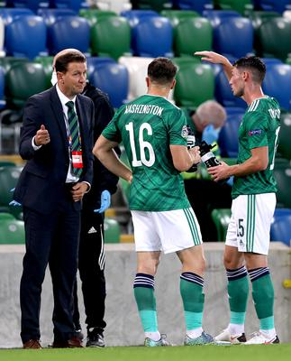 Ian Baraclough, left, said his players have 'unfinished business' in qualifying play-offs (Liam McBurney/PA)