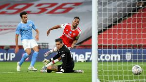 Arsenal's Pierre-Emerick Aubameyang scores his side's second goal against Manchester City (PA)