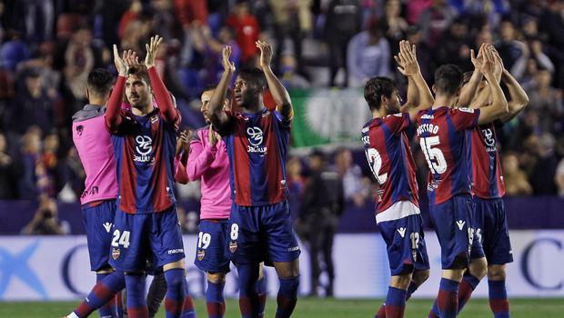 Levante's players celebrates their victory against Barcelona