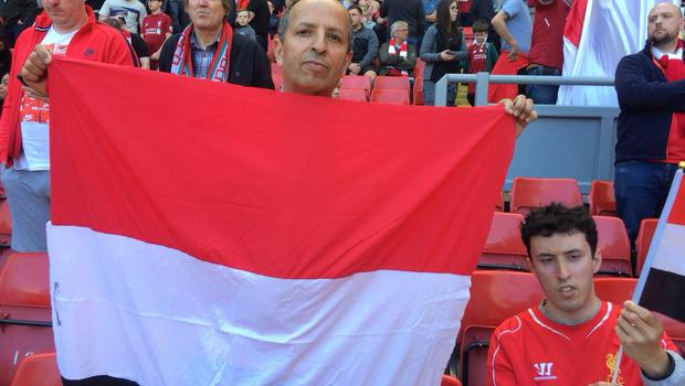 Chair of the Liverpool Arabic Centre Razak Mossa (left) and Haitham Mossa display their support for Mohamed Salah on the Kop at Anfield.