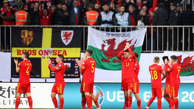 Wales players applaud the fans after the final whistle (Bradley Collyer/PA)