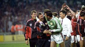 Sir Alex Ferguson celebrates with Les Sealey after winning the FA Cup in 1990 (PA)