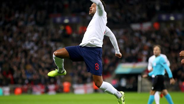 Alex Oxlade-Chamberlain celebrates against Montenegro – he also scored the last time England hit seven or more (Nick Potts/PA)