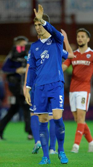 Farewell? John Stones waves to the Everton fans last night