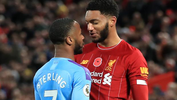 Liverpool's Joe Gomez, right, and Manchester City's Raheem Sterling clashed at Anfield (Peter Byrne/PA)