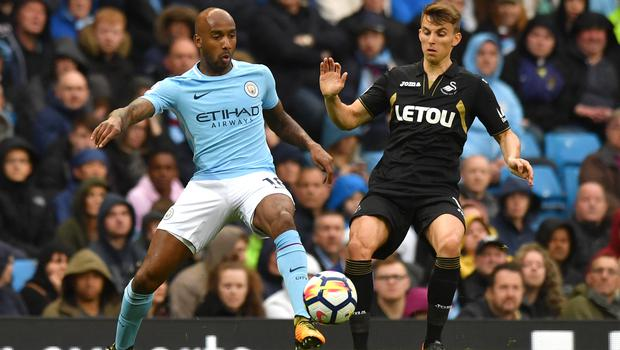 Fabian Delph, left, has impressed in various positions for Manchester City