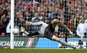 Jens Lehmann saves Paul Scholes' spot kick as Arsenal became the first club to win the FA Cup after a penalty shoot-out in 2005 (Rebecca Naden/PA)
