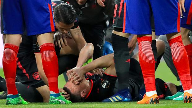 Arsenal skipper Laurent Koscielny was carried off on a stretcher following an early injury