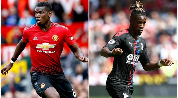 Paul Pogba and Wilfried Zaha (Martin Rickett/Tim Goode/PA)