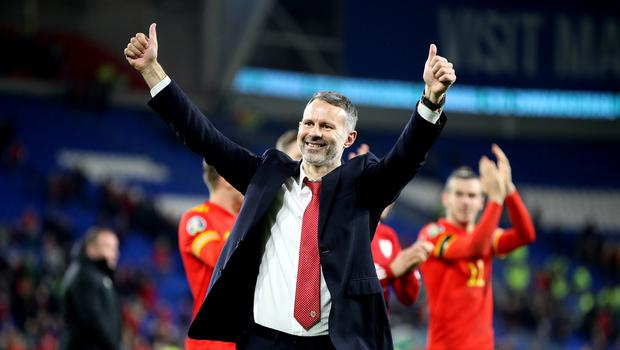 Wales manager Ryan Giggs celebrates victory and qualification (Nick Potts/PA)