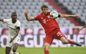 Thomas Muller scored his side's second goal just before half-time (Andreas Gebert/AP)