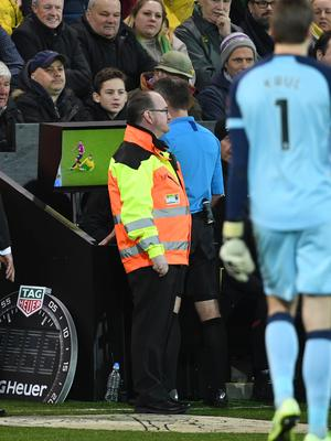 Paul Tierney consulted the pitchside monitor before changing Norwich City's Ben Godfrey's card from a yellow to a red (Joe Giddens/PA)