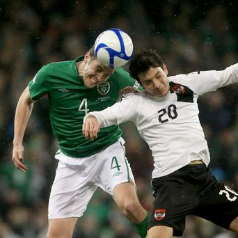 John O'Shea, left, wore the captain's armband in the absence of the injured Robbie Keane against Austria