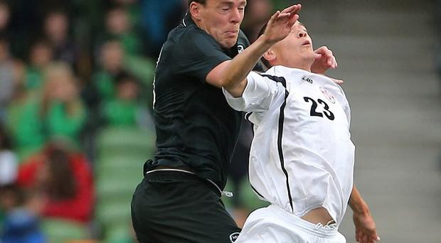 Richard Dunne, left, made his return from a groin problem in Ireland's win over Georgia