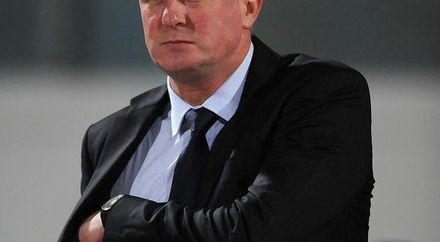 Tommy Wright has left Michael O'Neill's, pictured, coaching staff at Northern Ireland