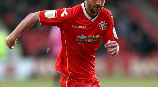 Will Grigg has penned a three-year deal with Brentford
