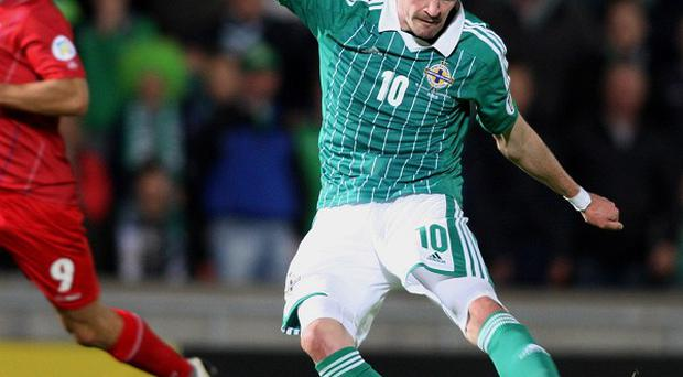 Kyle Lafferty, right, is set to lead the line for Northern Ireland against Russia