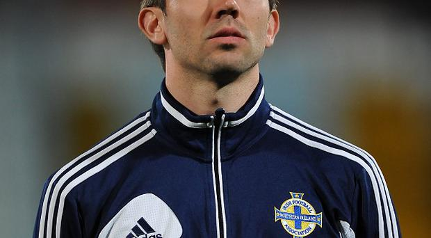 Gareth McAuley admits Northern Ireland are desperate to secure a victory against Russia