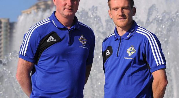 Michael O'Neill, left, has been backed by Steven Davis, right